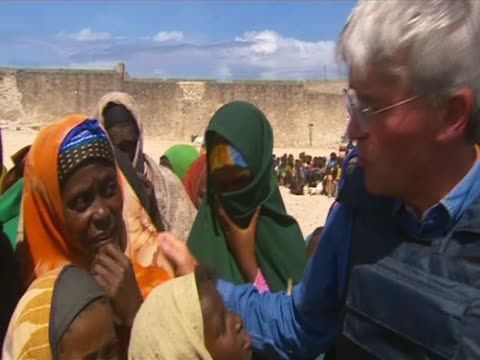 Andrew Mitchell Secretary of State for International Development visits drought victims in Mogadishu Somalia August 2011