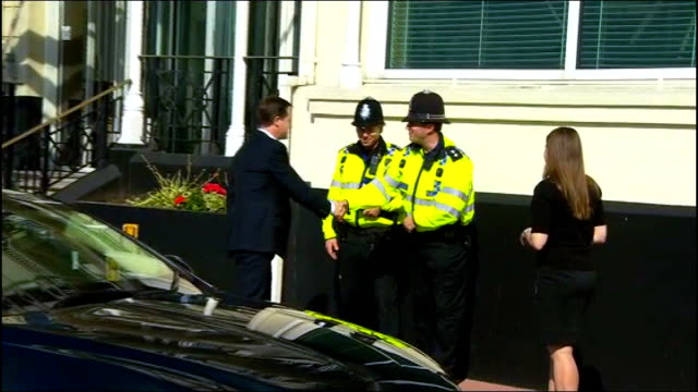 vídeos y material grabado en eventos de stock de andrew mitchell under pressure over downing street police row england east sussex brighton ext nick clegg mp out of car and shaking hands with police... - east sussex