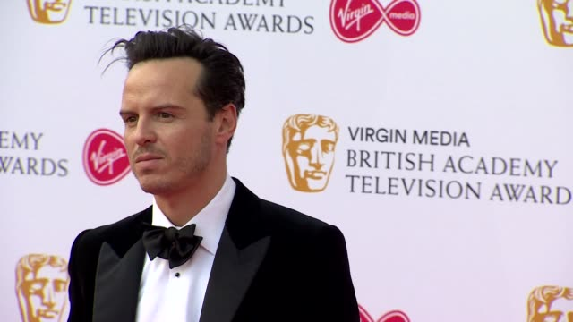 andrew scott poses for photos on red carpet at bafta tv awards 2019 at royal festival hall london - british academy television awards stock videos & royalty-free footage