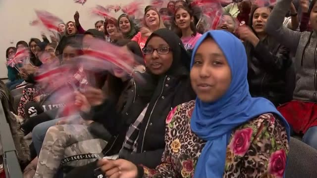 Andria Zafirakou wins Global Teacher Prize ENGLAND London Brent Alperton Community School INT Group of students waving Union flags and cheering SOT...