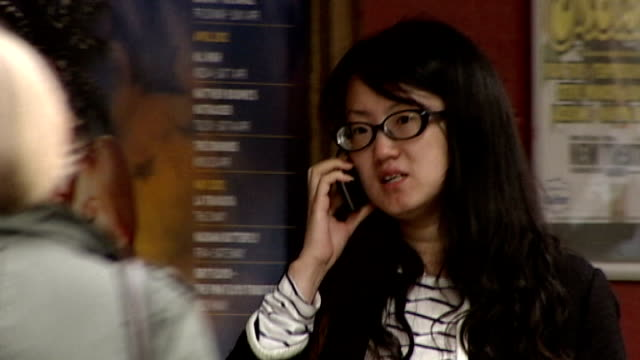 android apps share personal data with advertisers; r19081101 england: oxford: ext woman speaking on mobile phone as along street - オックスフォードシャー点の映像素材/bロール