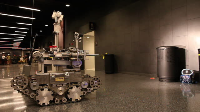 WIDE SHOT Andros robot identifies explosive device - members of US Marines and FDNY take part in joint drill aimed at strenghting preparedness for chemical and biological attacks at Barclays Center