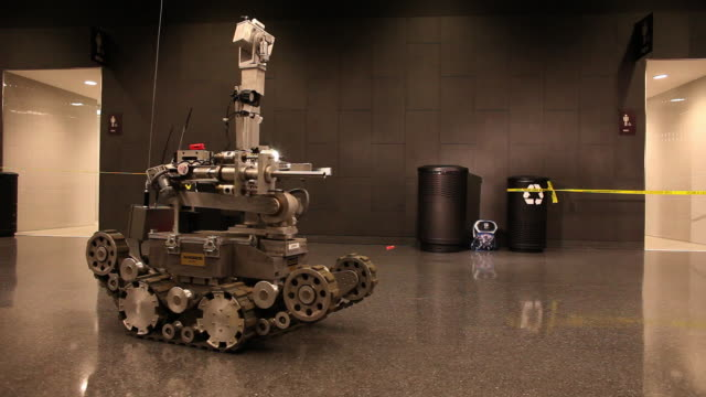 WIDE PAN Andros robot moves through corridor and identifies explosive device - members of US Marines and FDNY take part in joint drill aimed at strenghting preparedness for chemical and biological attacks at Barclays Center