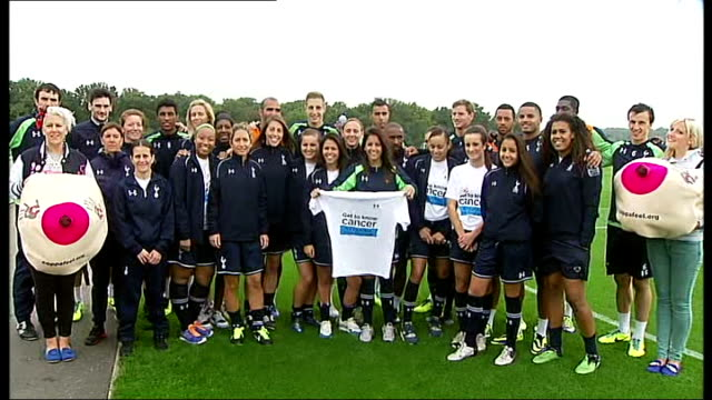 andros townsend at spurs cancer awareness event england london enfield ext ladies playing football at spurs training ground / players posing for... - individual event stock videos & royalty-free footage