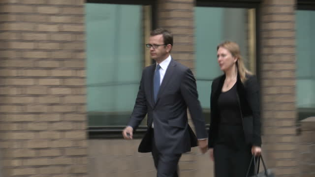 andy coulson arrives and departs from southwark crown court he pleaded not guilty to charges of phone hacking and alledged illegal payments andy... - andy coulson stock videos & royalty-free footage