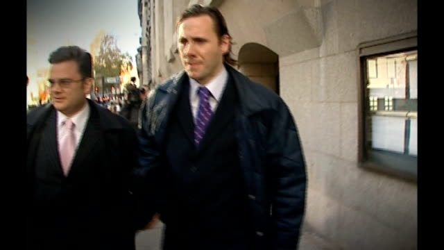 andy coulson detained by police in scotland over allegations of perjury tx london old bailey photography *** glenn mulcaire along outside court - andy coulson stock videos & royalty-free footage