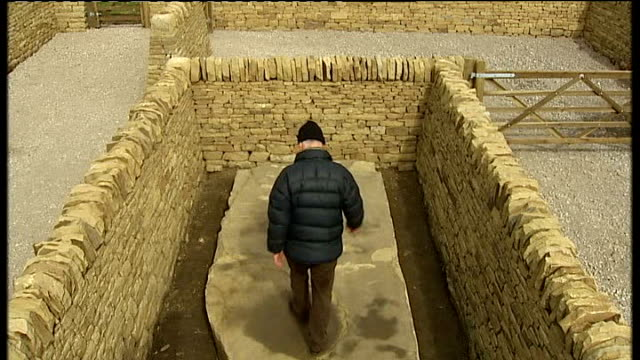 andy goldsworthy retrospective exhibition at yorkshire sculpture park ext various shots of reporter climbing into exhibit consisting of slab of... - sandstone stock videos & royalty-free footage