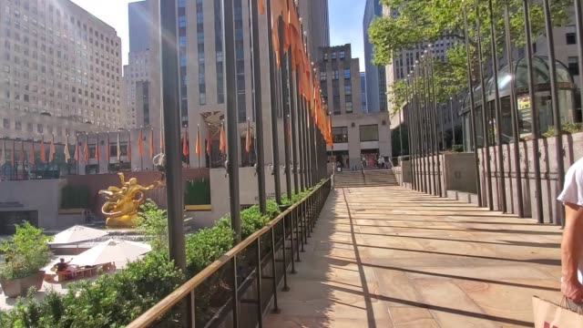 andy goldsworthy's red flags replace rockefeller center's conventional flags at frieze sculpture at rockefeller center as the city continues phase 4... - manhattan new york city stock videos & royalty-free footage