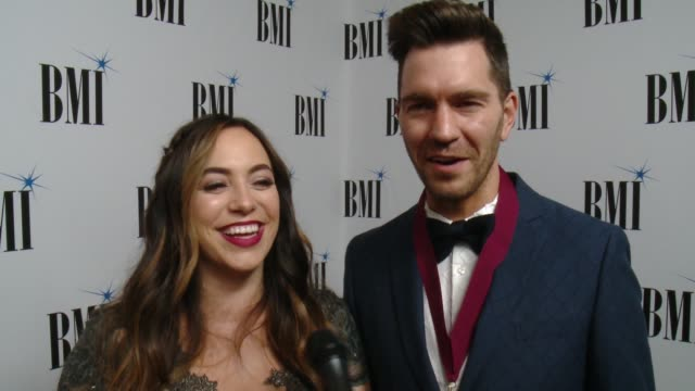 INTERVIEW Andy Grammer Aijia Lise on the event at 65th Annual BMI Pop Awards in Los Angeles CA