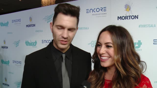 vídeos de stock e filmes b-roll de andy grammer and aijia grammer on being here tonight, on performing at the thirst project's 8th annual thirst gala at the beverly hilton hotel on... - the beverly hilton hotel