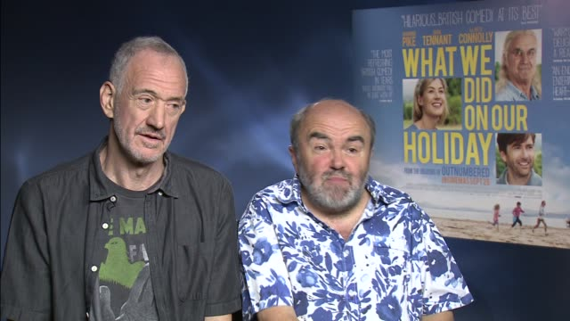 vídeos de stock e filmes b-roll de interview andy hamilton guy jenkin on the ideas behind the film and working with billy connolly at 'what we did on our holiday' interviews on... - billy connolly