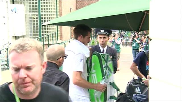 Andy Murray arrival at Wimbledon ENGLAND London Wimbledon EXT Andy Murray out of car and along / Murray along through security gates / Murray has...