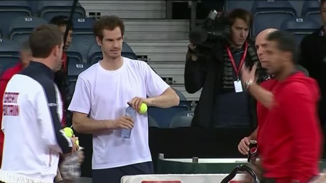 andy murray interview ahead of davis cup final; belgium: ghent: int andy murray chatting to belgian team member as joined by others various shots of... - davis cup stock-videos und b-roll-filmmaterial