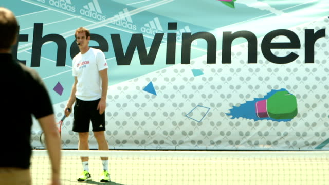 Andy Murray interview Andy Murray plays Adidas #hitthewinner game / Murray posing with Wimbledon trophy / Murray playing tennis with members of...