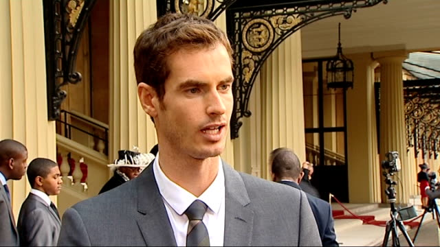 andy murray receives obe from prince william england london buckingham palace ext andy murray interview sot on prince william's handwriting not being... - バッキンガムシャー点の映像素材/bロール