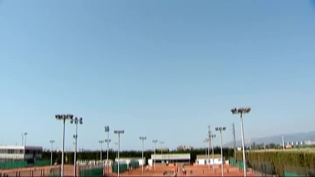 Andy Murray's Wimbledon victory built on the clay courts of Spain SPAIN Barcelona SanchezCasal Tennis Academy Blue sky TILT DOWN wide shot people...