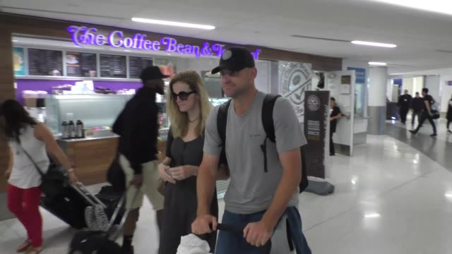 andy roddick brooklyn decker arriving at lax airport in los angeles in celebrity sightings in los angeles - andy roddick stock videos and b-roll footage