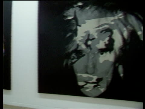 London Warhol arrives at London Gallery Warhol paintings as music played by David Bowie Warhol looking round exhibition Intvw Andy Warhol on the...