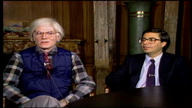 Andy Warhol Interview at The Factory Studio sitting with Bob Colacello editor of Interview Magazine