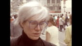 Andy warhol walks along 42nd street crowded with people past shops video id455101858?s=170x170