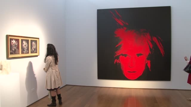andy warhol's 'sixteen jackies' of the former us first lady and a selfportrait are competing for top dollar in this week's contemporary art auctions... - sotheby's stock videos and b-roll footage