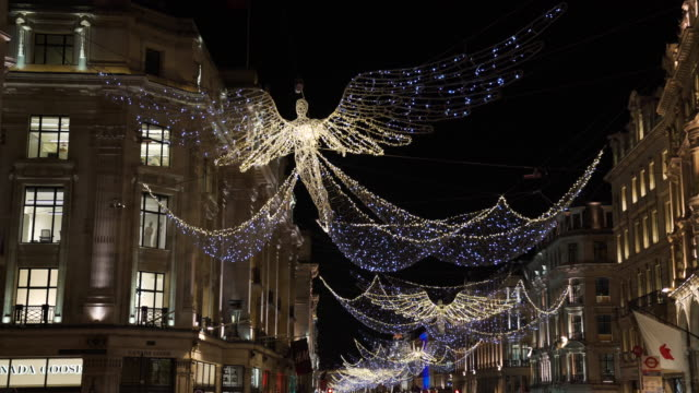 vídeos de stock e filmes b-roll de angel christmas decorations light up regent street, london - fairy lights