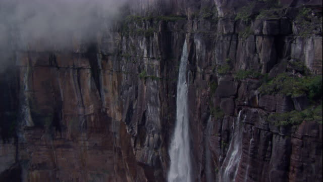 Angel Falls crashes over a sheer cliff in Venezuela. Available in HD.