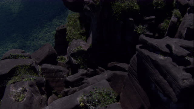Angel Falls tumbles over boulders and spills over sheer cliffs. Available in HD.