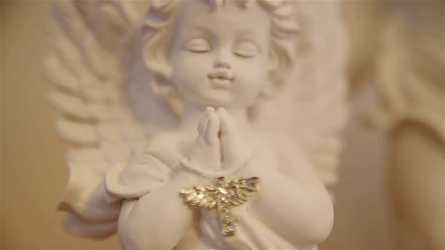 angel figurine -religious concept - symbol stock videos & royalty-free footage
