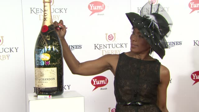 Angela Bassett at Moet Chandon Toasts The 139th Kentucky Derby at Churchill Downs on May 04 2013 in Louisville Kentucky