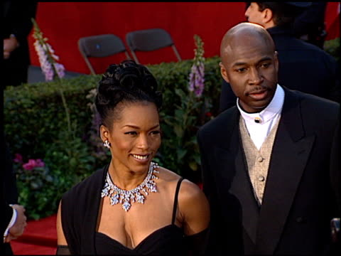 vídeos de stock, filmes e b-roll de angela bassett at the 1996 academy awards arrivals at the shrine auditorium in los angeles california on march 25 1996 - 1996