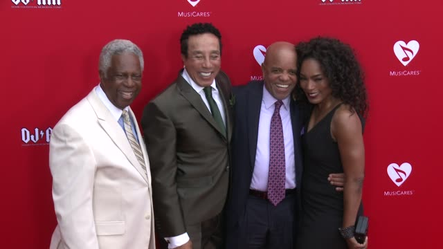 Angela Bassett Berry Gordy and Smokey Robinson at the 12th Annual MusiCares Map Fun Benefit Concert Honoring Smokey Robinson at The Novo by Microsoft...