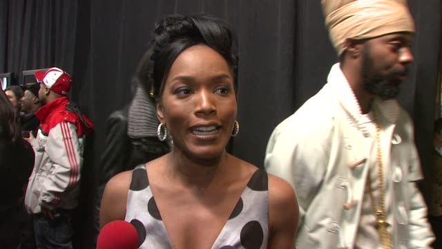 Angela Bassett on what it was like to play BIG's mother Voletta Wallace and what she thinks it was about BIG that made him so lovable She is wearing...