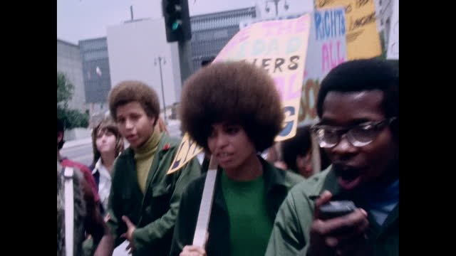 angela davis and others are picketing in front of the ucla extension building where the regents were holding a meeting on the status of her... - human rights or social issues or immigration or employment and labor or protest or riot or lgbtqi rights or women's rights stock videos & royalty-free footage