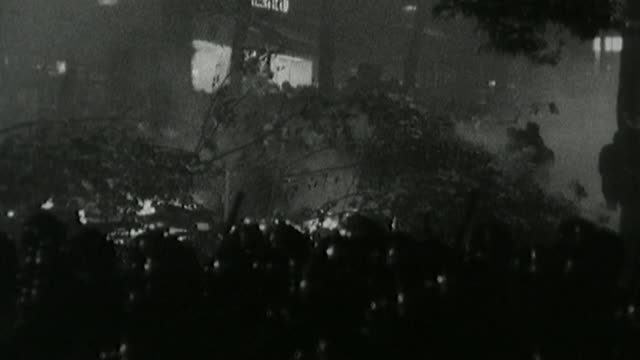 angela davis interview s31070702 / tx paris ext / night b/w fire burning and smoke rising in the street b/w crowd of riot police running along b/w... - 1968 stock-videos und b-roll-filmmaterial
