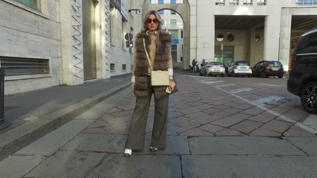 Angela Maria Franco is wearing Penny Black trousers vintage fur vintage bag Zara shoes and Safilo glasses on January 15 2017 in Milan Italy