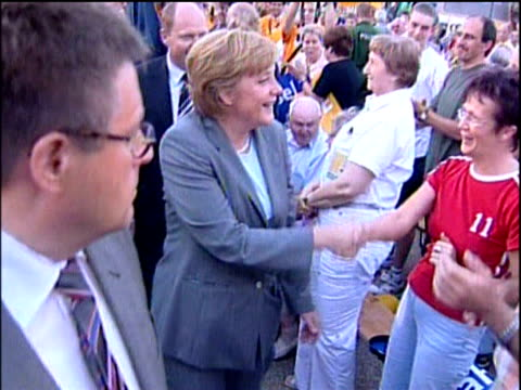 angela merkel chairwoman of christian democratic union shakes hands with people during election campaign walkabout magdeburg 4 sep 05 - アンゲラ・メルケル点の映像素材/bロール