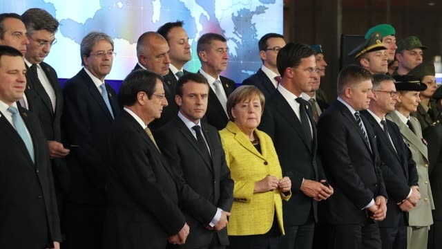 Angela Merkel Germany's chancellor and Emmanuel Macron France's president stand among other European leaders for a photograph during a news...