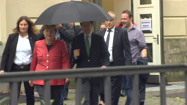 Angela Merkel leaves a polling station having voted on the day of the German federal election September 2017 NNBY446R ABSA627D