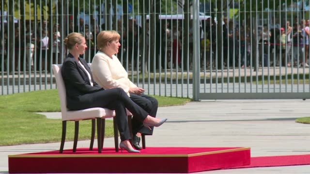 angela merkel sits through national anthems during an official ceremony as the german chancellor seeks to prevent a repeat of uncontrollable shaking... - chancellor stock videos and b-roll footage