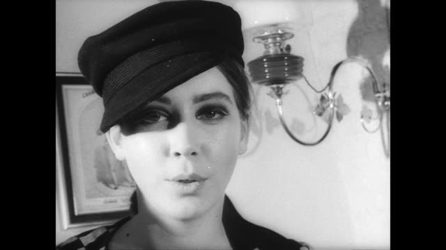 angela of london designer reveals spring collection in manchester / models in mod style with polka dots and lots of hats / model in bikini covered... - 1965年点の映像素材/bロール