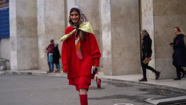angela rozas saiz wears a bimba y lola scarf over the head, a red wool oversize pullover, a dior saddle bag, red shorts, red long socks, bejeweled... - scarf stock videos & royalty-free footage