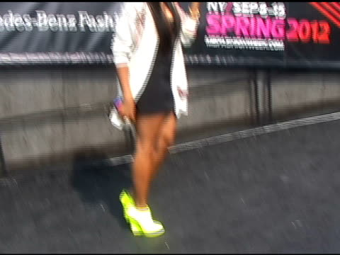 Angela Simmons pauses for a moment before heading into Fashion Week in New York 09/15/11