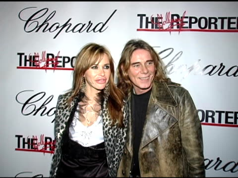 Angelika Bolligr and George Blodstone at the Jason Davis Chopard and The Hollywood Reporter Party to Benefit The Nancy Davis Foundation at Chopard in...
