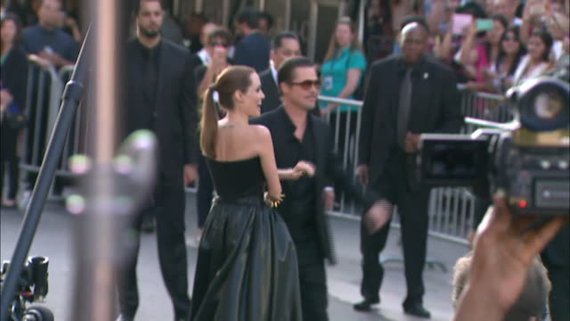 Angelina Jolie and Brad Pitt arrival Disney's Maleficent World Premiere at the El Capitan Theatre on May 28 2014 in Hollywood California
