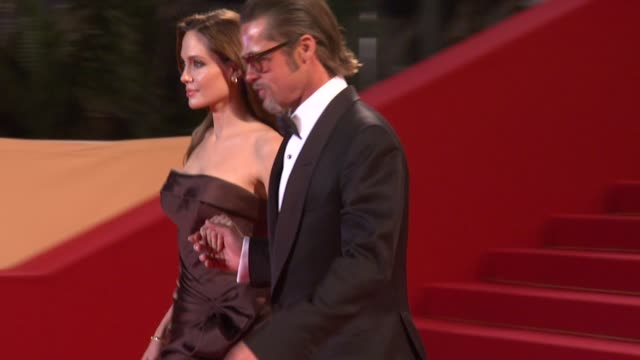 angelina jolie and brad pitt at the 'l'apollonide' premiere during the 64th annual cannes film festival at the l'apollonide premiere: 64th cannes... - 俳優 ブラッド・ピット点の映像素材/bロール