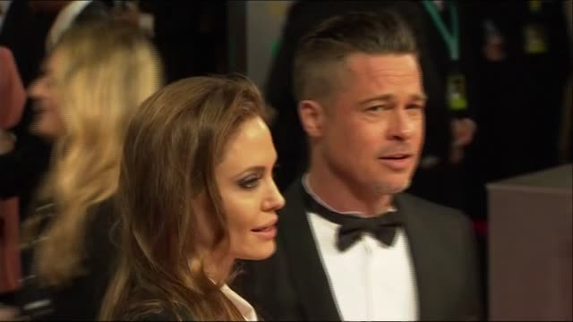 angelina jolie and brad pitt pose for photographers at the baftas 2014 - brad pitt actor stock videos & royalty-free footage