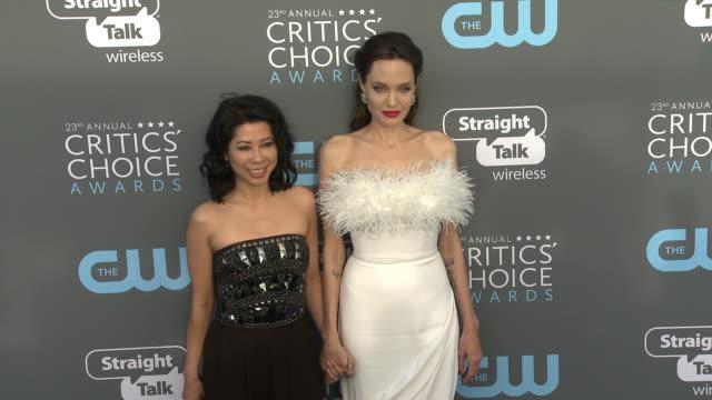 Angelina Jolie and Loung Ung at the 23rd Annual Critics' Choice Awards at Barker Hangar on January 11 2018 in Santa Monica California