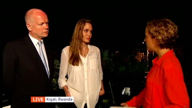 angelina jolie and william hague visit africa for anti-rape campaign; rwanda: kigali: ext / night angelina jolie and william hague mp live interview... - キガリ点の映像素材/bロール