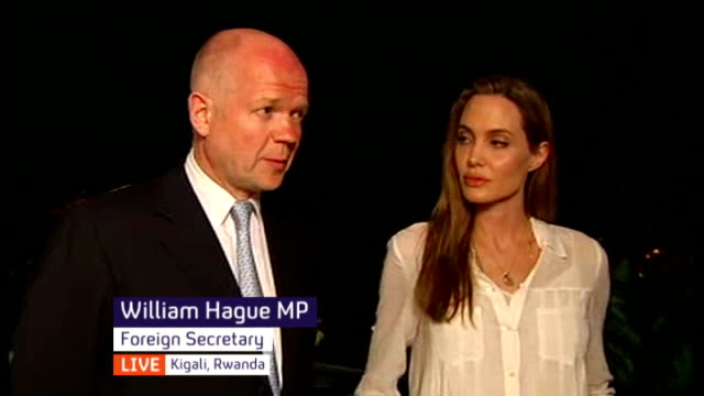 angelina jolie and william hague visit africa for anti-rape campaign; rwanda: kigali: ext / night jolie and hague live interview sot - キガリ点の映像素材/bロール